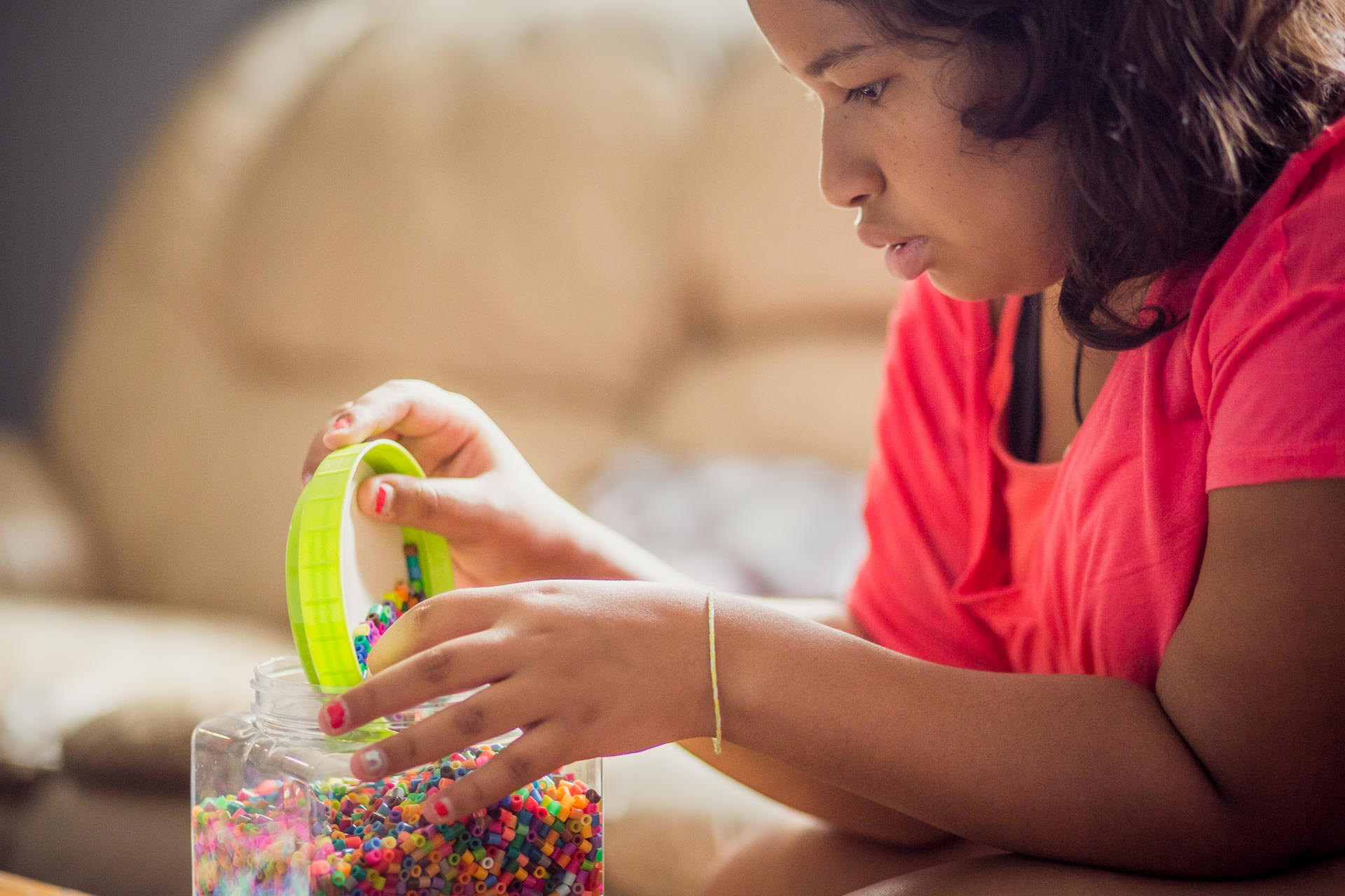 Veronica cleans up perler beads