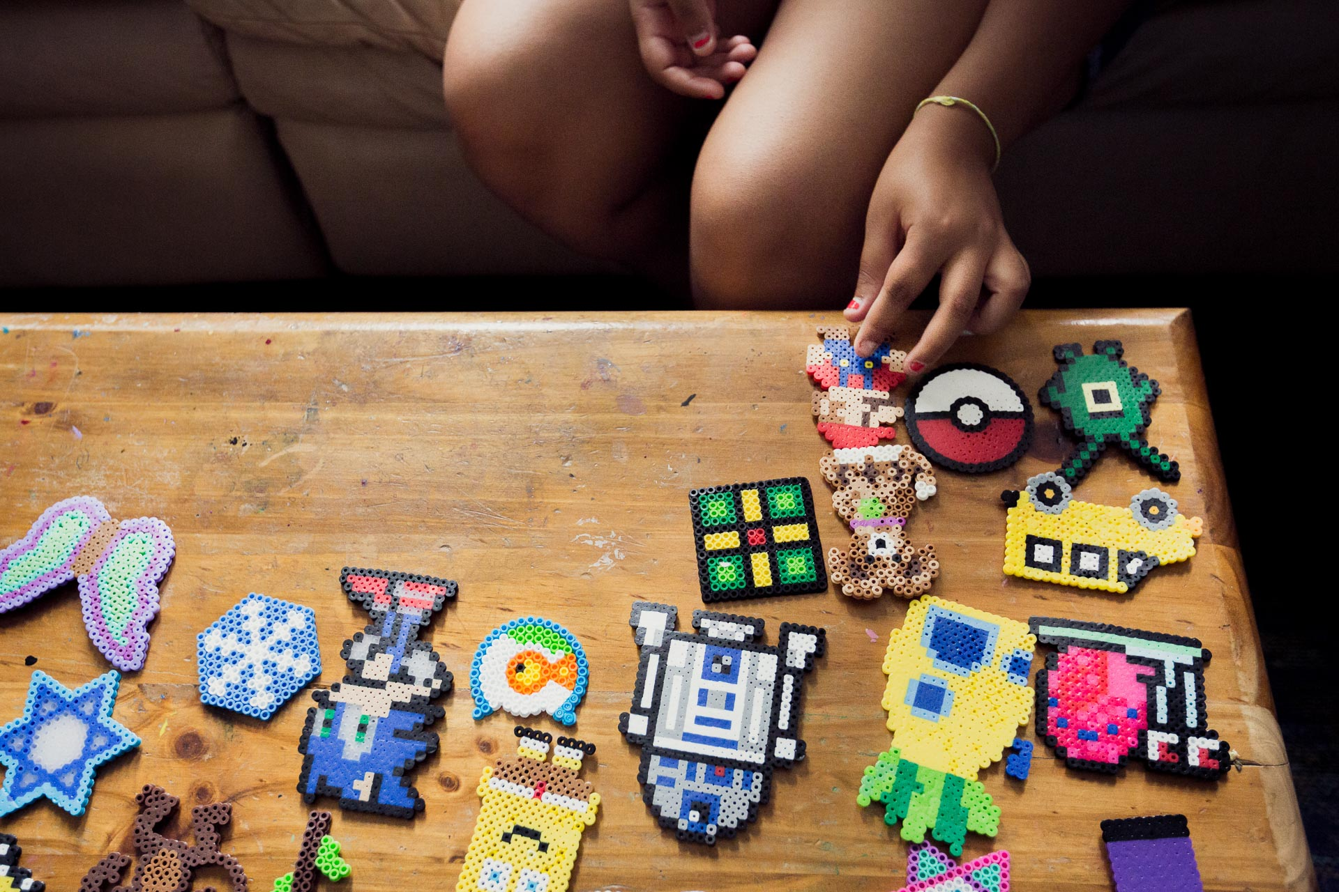 Veronica adjusts her perler bead collection
