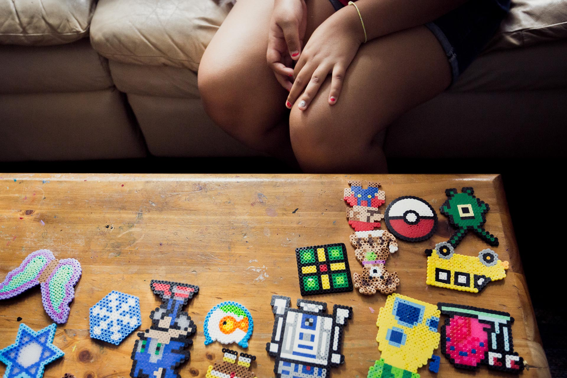 Veronica looks at her perler craft collection