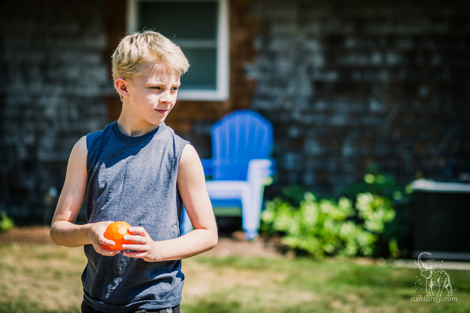 boy about to throw an orange ball