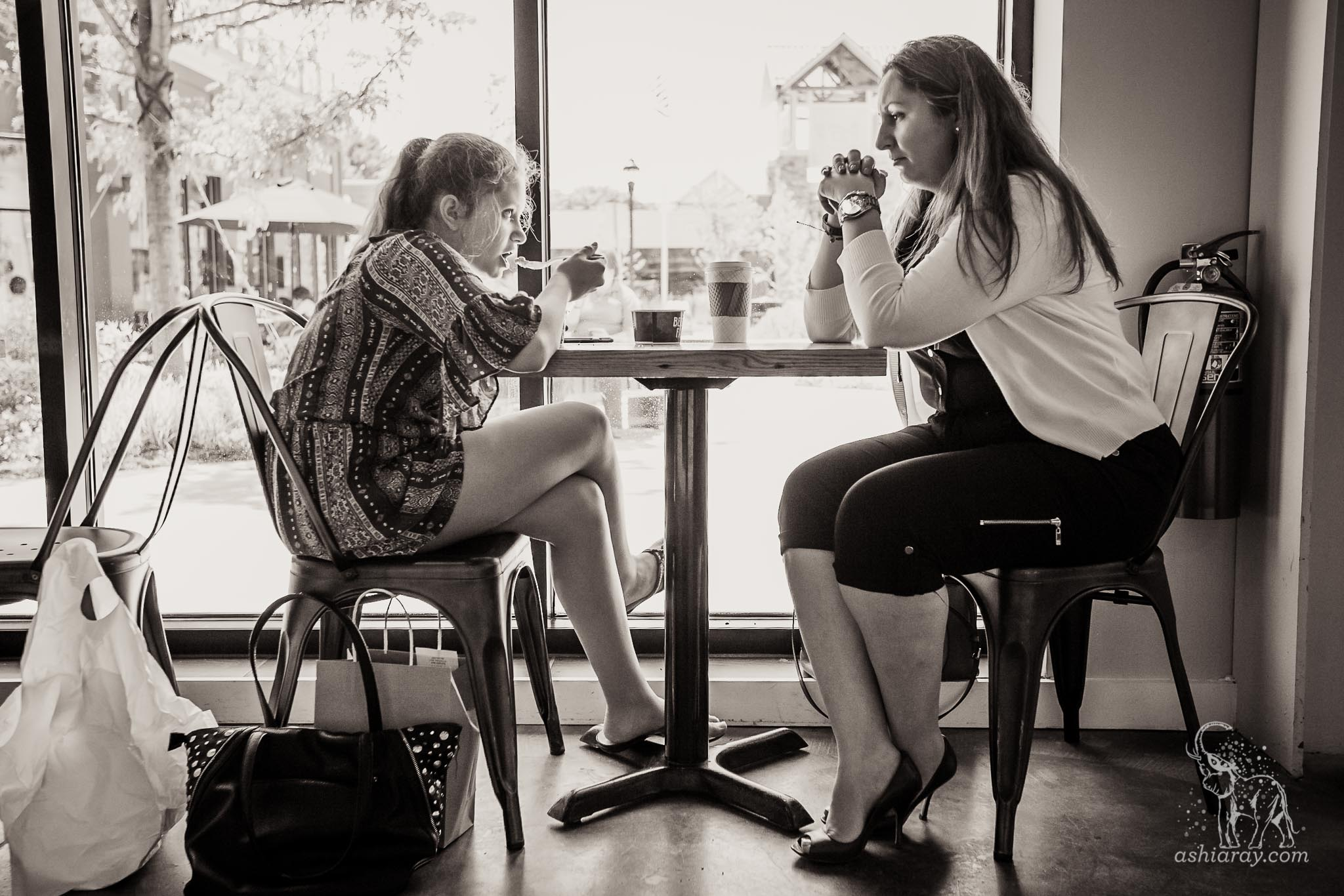 Mother and daughter eat ice cream and talk