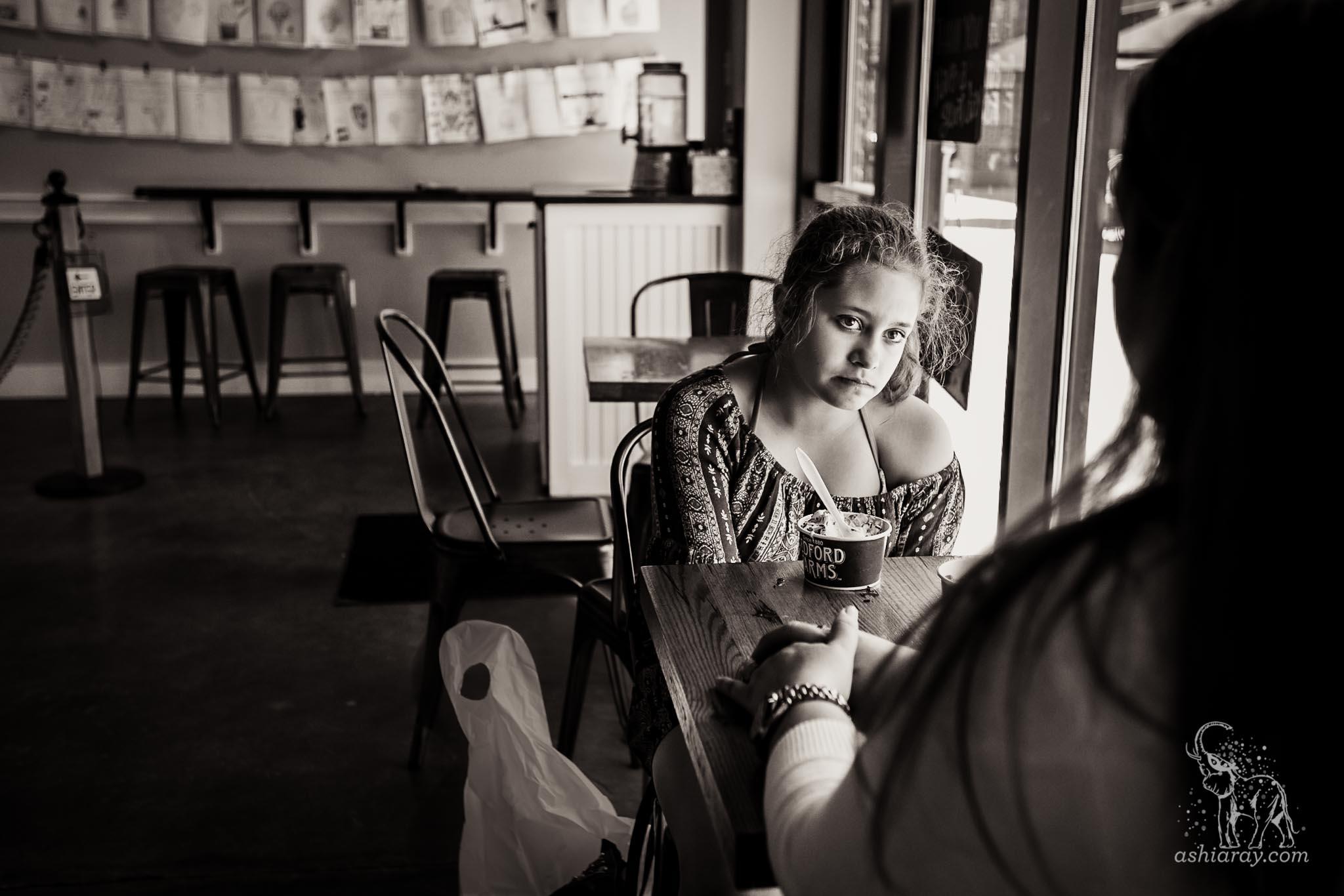 Teen girl looking serious in restaurant