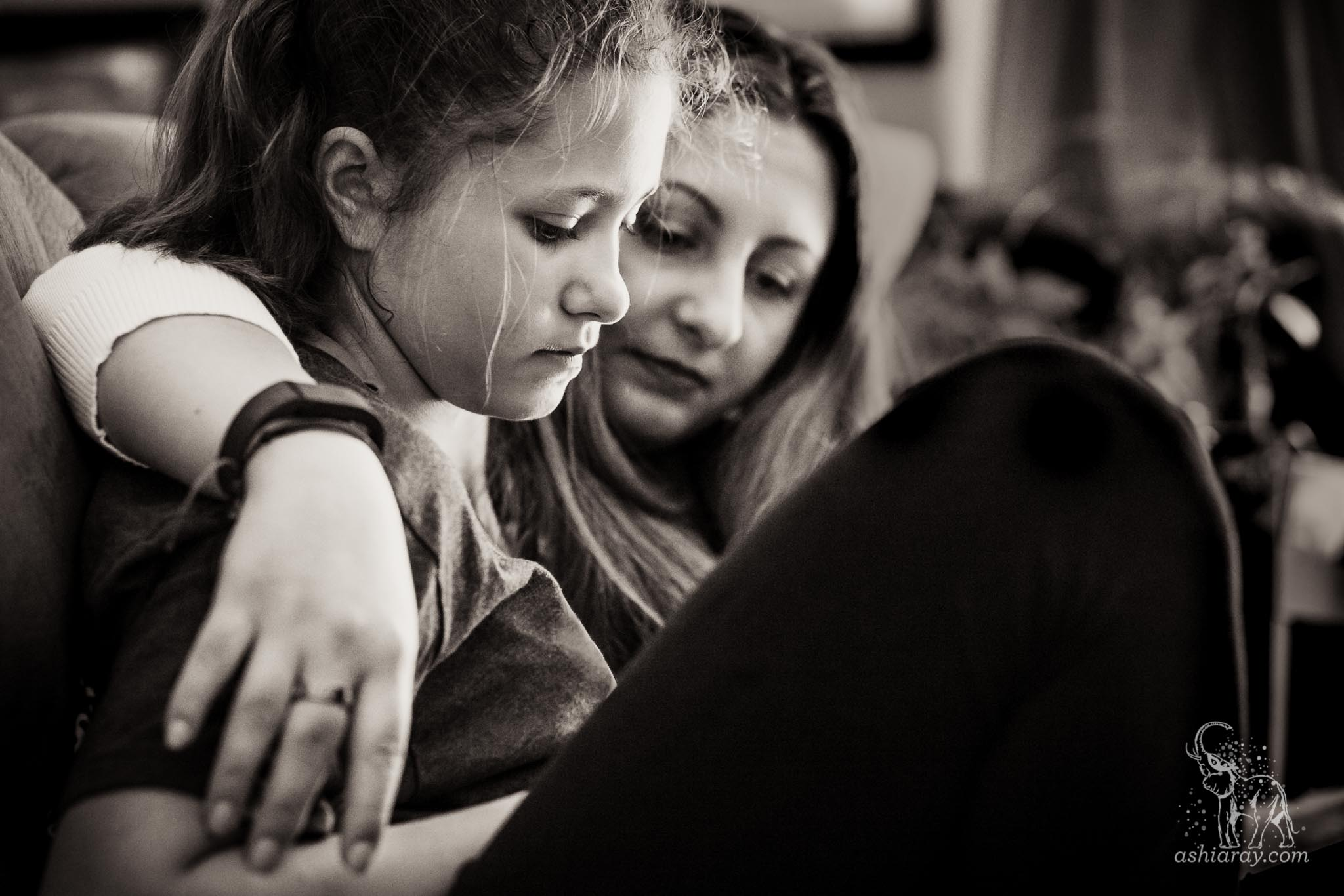 Mother and daughter looking at a phone