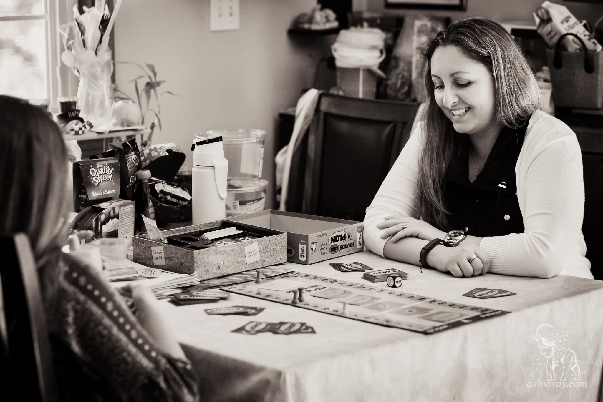 Woman smiles while playing board game