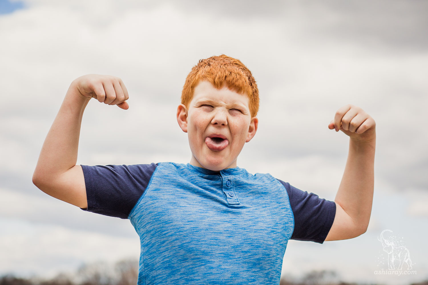 13-year-old boy flexes his muscles and makes silly faces